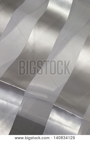 This is a photograph of striped White Polyester fabric scarf with sheer insert