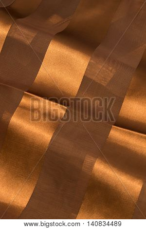 This is a photograph of Brown Polyester fabric with sheer insert