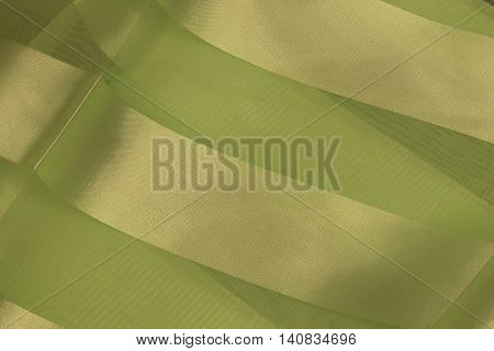 This is a photograph of Lime Green Polyester fabric with sheer insert
