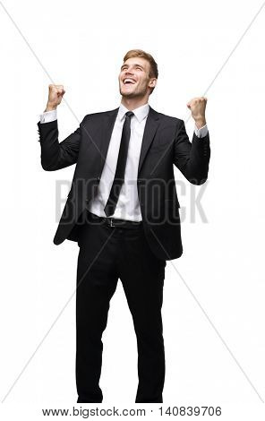 Business man celebrating a triumph with arms up