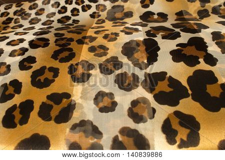 This is a photograph of a Leopard print polyester scarf