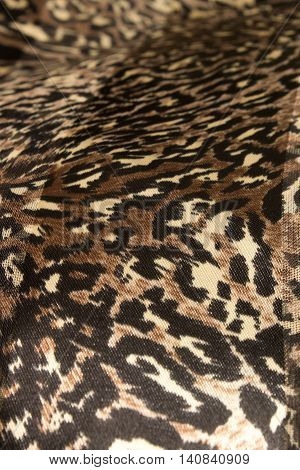 This is a photograph of an animal print polyester fabric scarf