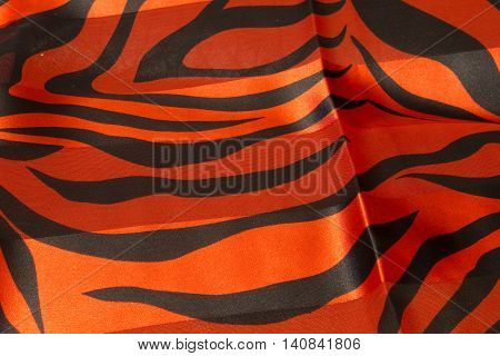 This is a photograph of a Red and Black Zebra print polyester fabric