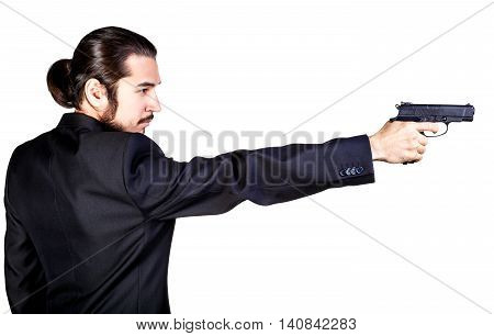 Gangster man in black suit aiming gun on white background
