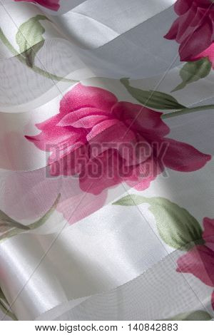 This is a photograph of a Pink and Green floral print polyester scarf