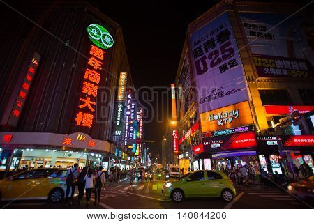 TaipeiTaiwan - November 7 2015 : Night scene of the Ximending it is the source of Taiwan's fashion subculture and Japanese culture.People can seen walking and shopping around it.