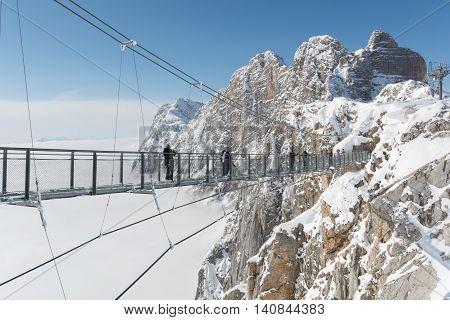 Austria's highest bridge at Dachstein Mountains underground foggy