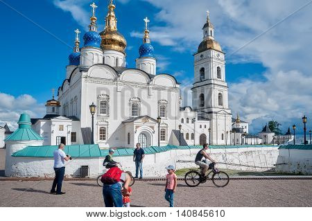 Tobolsk, Russia - July 15, 2016: Kremlin complex. Group of tourists near St Sophia-Assumption Cathedral and belltower 1587 foundation year