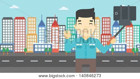 An asian man making selfie with a selfie-stick. Man taking photo with cellphone and waving on a city background. Vector flat design illustration. Horizontal layout.