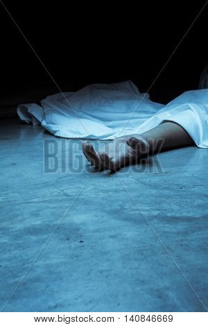 dead body, laying on a floor. showing hand of the dead
