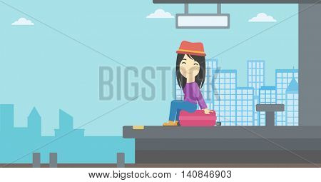 An asian young woman sitting on a suitcase at the train station on the background of arriving train. Woman waiting for a train at the platform. Vector flat design illustration. Horizontal layout.
