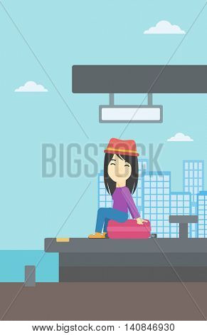 An asian young woman sitting on a suitcase at the train station on the background of arriving train. Woman waiting for a train at the platform. Vector flat design illustration. Vertical layout.