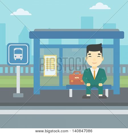 An asian young man waiting for a bus at a bus stop on a city background. Young man sitting at the bus stop. Vector flat design illustration. Square layout.