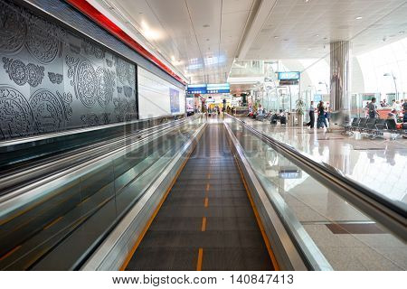 DUBAI, UAE - MAY 13, 2016: inside of Dubai International Airport. Dubai International Airport is the primary airport serving Dubai, United Arab Emirates.
