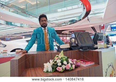 DUBAI, UAE - MAY 13, 2016: indoor portrait of a man at Dubai International Airport. Dubai International Airport is the primary airport serving Dubai, United Arab Emirates.