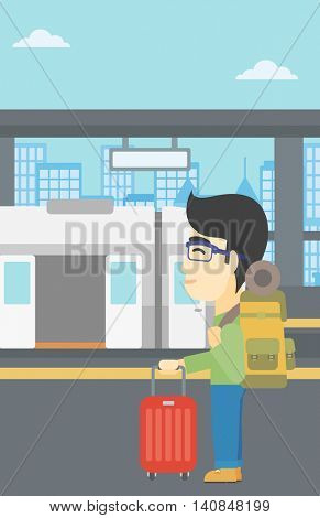An asian young man standing at the train station on the background of train with open doors. Young man with suitcase waiting for a train. Vector flat design illustration. Vertical layout.