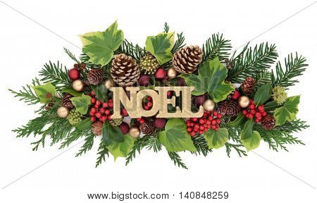 Christmas and winter decoration with noel glitter sign, red and gold bauble decorations, holly, ivy, gold pine cones and fir leaf sprigs over white background.