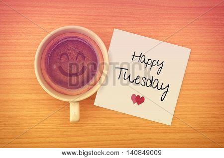 Happy Tuesday on paper note with coffee cup,top view.
