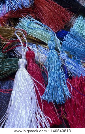 This is a photograph of colorful thread tassel
