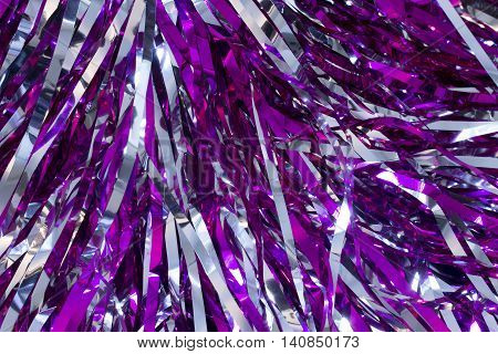 This is a closeup photograph of Cheerleader silver and purple pom poms