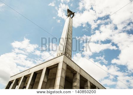 Slavin is the memorial monument and military cemetery in Bratislava the capital of Slovak republic. Cultural heritage. Architectural theme. Historical object. Russian soldier statue and cloudy sky.