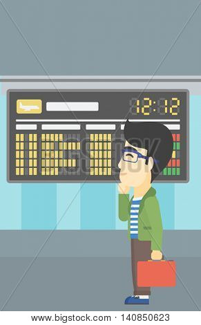 An asian young man with a briefcase looking at departure board at the airport. Passenger standing at the airport in front of departure board. Vector flat design illustration. Vertical layout.