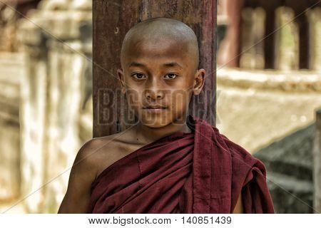 Novice boy Buddhist monk in temple at  Burma