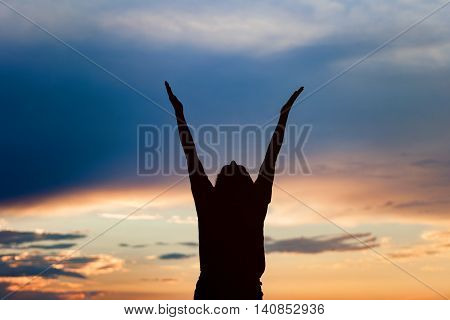 Young Woman Silhouette At Sunset