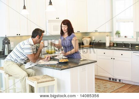 Couple together in kitchen