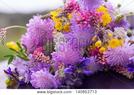 Bright colorful bouquet of field flowers close-up. Beautiful wildflowers mix, summer blossom concept