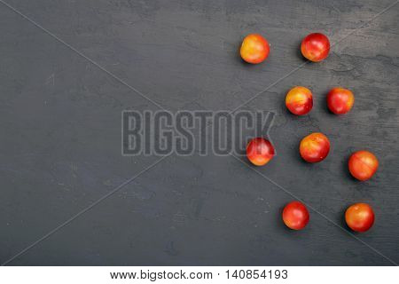 cherry plum in dark rough background with copy space top view