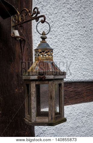 The old lantern on wall of farmhouse