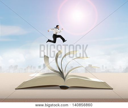 Man Running And Jumping On Open Book