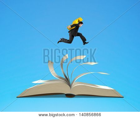 Businessman Carrying Usd Dollar Sign And Running On Open Book