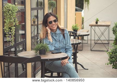 Asian woman model wearing black glasses smiling a happy in cafe at roadside in casual.