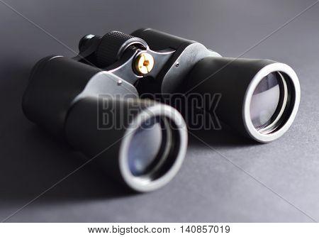 Binoculars, macro studio shot. Black binoculars with selective focus.