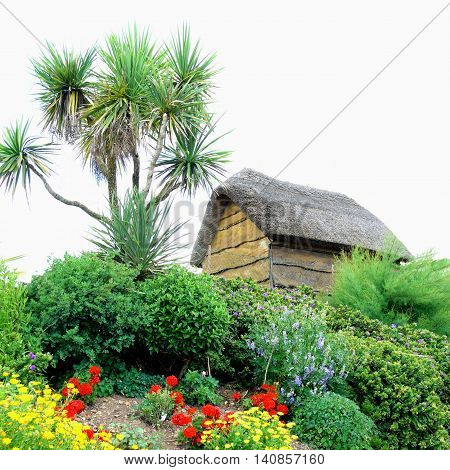 Wooden thatched building with garden on the hill