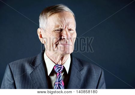 Businessman portrait with hesitation on face, isolated black background, emotions, people concept