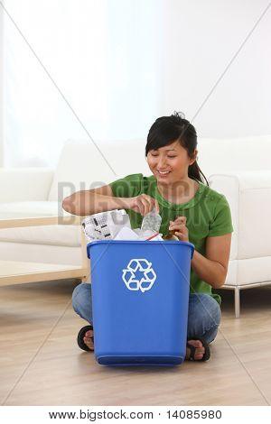 Woman putting items in recycle bin