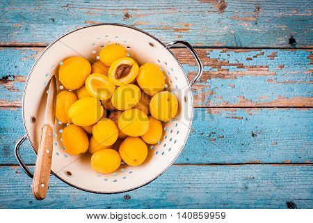 Fresh Ripe Organic Apricots In Colander  Above View