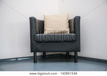 Guest chair with pillow at modern office