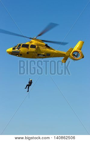 ROTTERDAM, HOLLAND - SEP 7, 2012: Demonstration of a rescue operation by helicopter during the World Harbor Days.