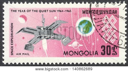 MOSCOW RUSSIA - CIRCA APRIL 2016: a post stamp printed in MONGOLIA shows a spaceship on Earth orbit the series