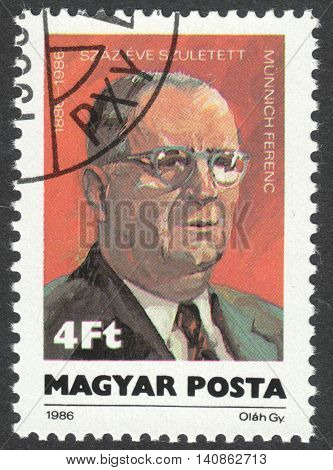 MOSCOW RUSSIA - CIRCA APRIL 2016: a post stamp printed in HUNGARY shows a portrait of Ferenc Munich devoted to the 100th Anniversary of the Birth of Ferenc Munich circa 1986