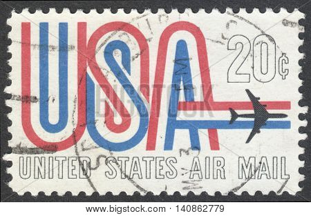 MOSCOW RUSSIA - CIRCA APRIL 2016: a post stamp printed in the USA shows symbols of American Airmail circa 1968