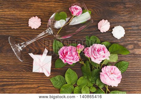 Wineglass With Light Pink Roses And Meringues