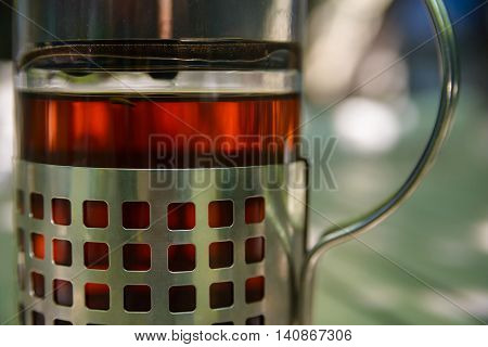 Close-up photo of french press teapot with tea