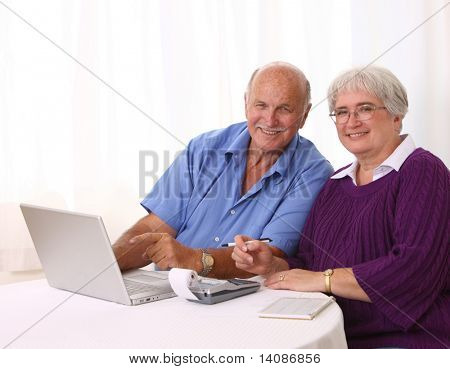 Senior couple working on finances
