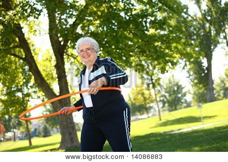 Senior woman with hula hoop