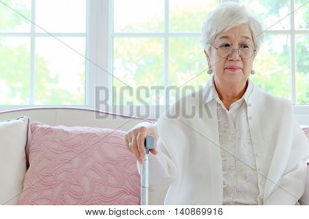 senior woman portrait,Retired woman with her walking stick